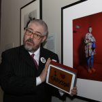 Jupitus draws an audience to sketch on an iPad